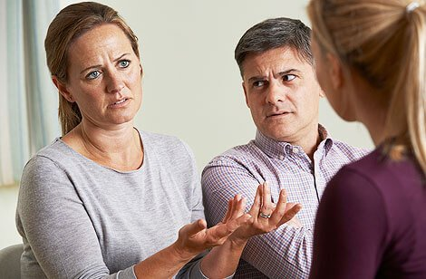 Stress with a couple speaking to counselor